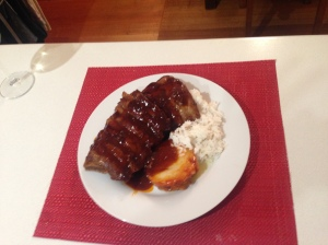 Ribs with sticky sauce, basmati rice and potato gratin stack