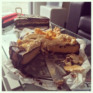 the two cakes. bake: espresso layered cake front: baked peanut butter cheesecake